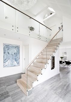 Nordic and simple staircase with wooden stairs and glass railing.