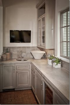 would love an area like this off the kitchen {paint color: Sherwin Williams Ermine}