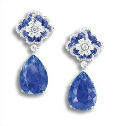 A Pair of Sapphire and Diamond Earrings. Two pear-shaped sapphires, 26.99 and 25.58 carats. Cabochon sapphires and smaller sapphires, altogether approximately 10.00 carats. Brilliant-cut diamonds, totaling approximately 2.25 carats 18 karat white gold. Ear-pendants detachable.
