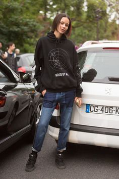 Binx casual in a printed hoodie and patched denim. Paris #BinxWalton #Offduty