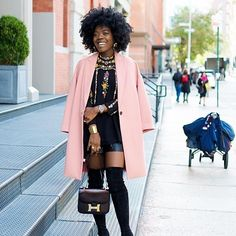 black natural hair blogger Simplycyn with pink coat and long boots