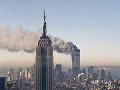 The twin towers of the World Trade Center burn behind the Empire State Building in New York, Sept. In a horrific sequence of destruction, terrorists crashed two planes into the World Trade World Trade Center Attack, Trade Centre, Empire State Building, 11 September 2001, July 11, Photo New York, Guernica, Rare Photos, Vintage Photographs