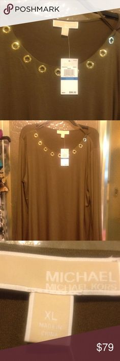 Michael by Michael Kors Long Sleeve Top Gorgeous Michael by Michael Kors Long Sleeve Grommet Embellished Top. Gold Round Style Grommets around the Neckline. Gold Michael Kors Logo at the bottom. New With Tags. Beautiful Brown neutral. Great for everyday or to pair with a fancier shirt or pant. I am always open to reasonable offers. 😸 Michael Kors Tops