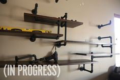 My new obsession. Man Made DIY...How to: Make a Rustic Built-In Shelves with Plumbing Pipes