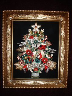 Vintage Jewelry Framed Christmas Tree! I have one of these, was left to us by a family member.... A good idea for your broach's after your wedding!!