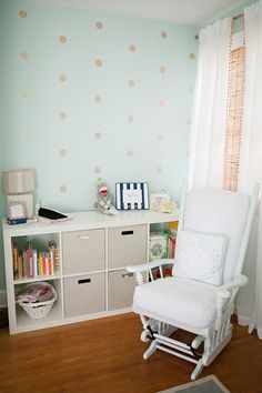 also kinda like the polka dot wall & pom pom curtains. & the mobile--cloud with stars in the colors of the room. think i could make that myself.