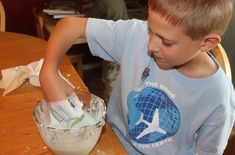 Science Experiment: Solids, Liquids, and Polymers!  All you need is cornstarch, water, and food coloring (optional).