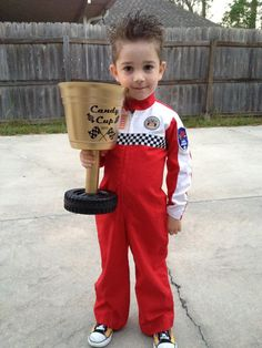 Rex's 2012 costume.  The race car driver suit was modeled after one on Pinterest, but the Candy Cup was 100% my genius idea (have to brag; I'm so proud of it)