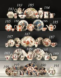 1765 A GROUP OF WORCESTER CHINOISERIE TEAWARES  Circa 1765  Each painted in black and enamelled in colours with figures at various pursuits, comprising: a globular teapot and cover, a hexagonal teapot stand, a small sugar-bowl, a coffee-cup, and a waste-bowl similarly decorated with arabesque ground panels 7in. (18.5cm.) wide, the teapot, overall (5) Christies lot183