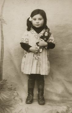 little girl with a Bleuette doll