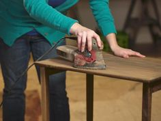 The experts at DIY Network provide instructions on how to strip, sand and stain a piece of wooden furniture.