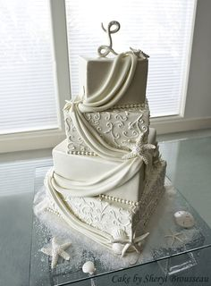 Alycia loves this!    It combines various elements from other cakes that I've loved...the draped fabric, the smooth vs. designed layers, and the shells
