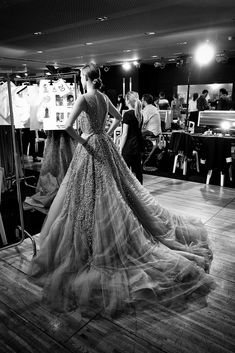 A model prepares to walk at the Elie Saab Fall 2014 Couture show.