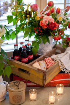 Old drink crates for a rustic look... Can be used to hold flowers, napkins, drinks, old photos, etc. Cute!