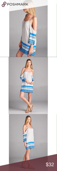 Open shoulder 3/4 sleeve border print tunic dress Blue color. Loose fit with spaghetti straps. Dresses
