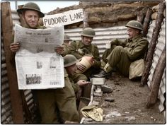 Men of the 1st Queen's Own Royal West Kent Regiment, 4th Infantry Division enjoy a tot of rum in a section of trench named 'Pudding Lane', near Roubaix, a commune in the Nord department in northern France. 3rd of April 1940.