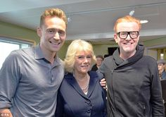 The Duchess of Cornwall today met heart-throb Tom Hiddleston, who broke royal protocal when wrapping an arm round Camilla pictured here with the actor and Radio 2 presenter Chris Evans