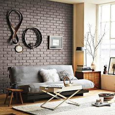 black-brick-wall-in-stylish-living-room