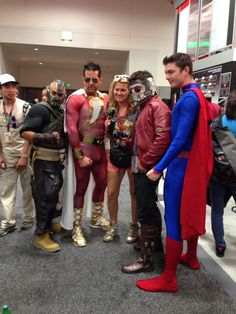 Thurs. - Interesting collection of characters. Bane, Shazam, Star Lord and Superman pose with a con-goer in the Exhibit Hall.