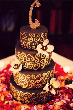 Chocolate fondant with hand painted gold scrolls for this wedding cake