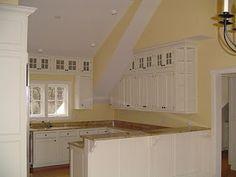 Small kitchen idea; cabinets around the window