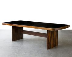 Joaquim Tenreiro, 'Soft-edged rectangular dining table in jacaranda with black underpainted glass top and curved legs. ', 1949
