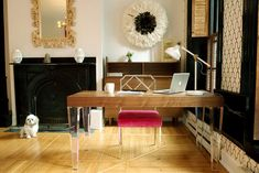 Art Deco Home Office with High ceiling, Hardwood floors, Bespoke Desk by Michele Plachter Design, metal fireplace