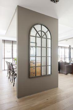"""Estructura en """"L"""" diseñada por Alejandra Pombo, que permite separar los espacios sin tener que crear estancias cerradas que no dejan circular la luz por la vivienda."""