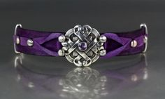 I used an old door knob and made a mold of it to form this focal piece.  I set an Alexandrite in fine silver metal clay and dyed the leather purple to match.--Lisa Barth