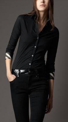 Burberry, all black outfit.  Back Pants & a  slim fit button up blouse.  Smooth style trend.