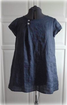 Those little buttons pull this one together so nicely. I love that super light and unruly look of Irish linen, and this midnight blue color is perfection.