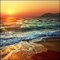 Colorful waves at sunset, Rhodes Island, Greece