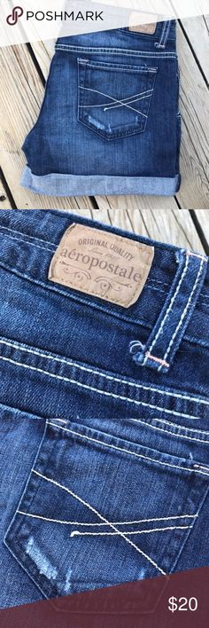 """Aeropostale Cuffed Midi Jean Shorts -- Size 7/8 Purchased new from Aeropostale, worn a couple times total. Size 7/8. Inseam is 4"""". Slight factory distress on pockets and left thigh.  Dark wash, cuffed at bottoms. Aeropostale Shorts Jean Shorts"""