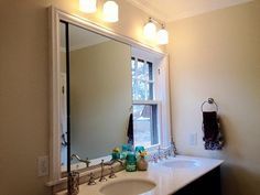 Bathroom Vanity Under Window how to hang a mirror on a window | hanging mirrors, wall spaces