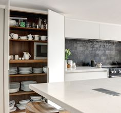 Roundhouse.   Luxury matt lacquer painted modern colourful bespoke kitchen