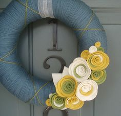 I love yarn wreaths - actually I like almost any wreath that doesn't have 'fake' flowers on it!