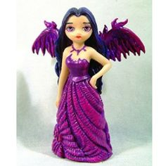Violet Angel in Long Dress. www.teeliesfairygarden.com. . . The Violet Angel in Long Dress is one of the mother fairies in Goth Fairyland. She wears a gorgeous long gown and purple angel wings. #strangelingfairy