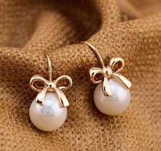 Golden Bow and Pearl Earrings