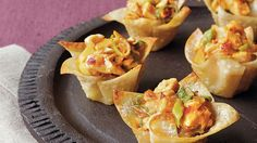 Fill wonton cups with cabbage and chicken mixture – a flavorful Asian-style appetizer to treat your guests.