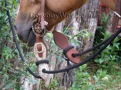 What are slobber straps? Slobber straps are pieces of leather that attach reins to a bit. They can be large or small, and plain or fancy. We explain the purpose of slobber straps.