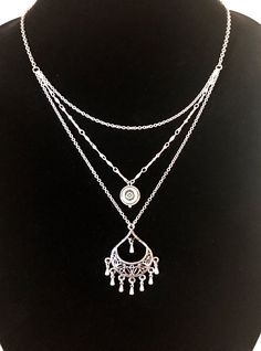 A personal favorite from my Etsy shop https://www.etsy.com/listing/522705614/silver-surgical-steel-chain-layered