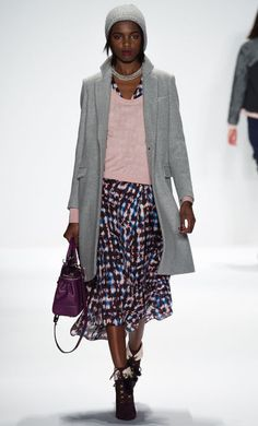 Midiskirts: The Leading Fall Fashion Trend on the Runways Is Making Covered-Up Cool  Rebecca Minkoff's preppy-pretty dress layers perfectly under a fine-knit V-neck sweater and wooly coat.