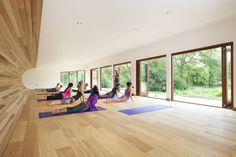 This long view of the yoga studio in full use highlights the breezy, open feel with all doors fully retracted.