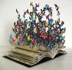 Wow.  Actually a metal sculpture by David Kracov . http://www.bitrebels.com/design/book-of-life-beautiful-butterflies-burst-from-this-stunning-book/