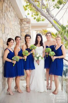Deep blue bridesmaids dresses combined with succulents perfect for this Sandos Finisterra Wedding! Hair and make-up by www.suzannemorel.com