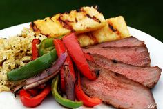 Caribbean jerk marinated london broil with grilled veggies, grilled pineapple and rice pilaf