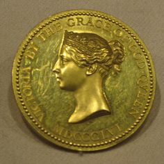 "MEDAL OF QUEEN VICTORIA.""For Success In Art"". It looks as though she is wearing her Sapphire and diamond tiara, a gift of Prince Albert, her husband. Awarded by the South Kensington Museum, now The Victoria & Albert Museum. Gold, by William Wyon, English, Struck: 1856. This specimen was presented to the American painter George F. Munn. (This not part of The Crown Jewels, a private jewel). The Metropolitan Museum of Art, NYC. Christian Orlov Photo 2015."