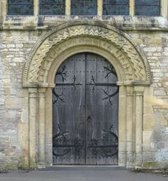 Spencer     Norman west doorway, the Church of St John the Baptist, Burford, Oxfordshire, England     The doorway dates from c.1175. The iron hinges are believed to be original, according to the church's Web site.    doors doors doors