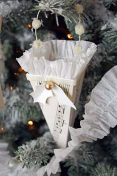 yum DIY - Christmas ornament A Field Journal: December 2010 Cute ornaments christmas trees. Paper Ornaments, Christmas Ornaments To Make, Noel Christmas, Victorian Christmas, Christmas Paper, Christmas Projects, All Things Christmas, Handmade Christmas, Holiday Crafts