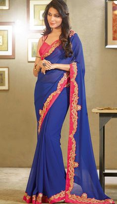 This gorgeous blue coloured #saree having graceful embroidery finished with resham, zari and patch work. Its superbly designed pink border is innovative and creative to give you perfect look for any occasion.
